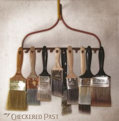 Brilliant way to reuse a rake head, as a way to hang paintbrushes!