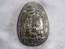 Antique / vintage tin half chocolate egg mould - rabbits in cabbage patch design