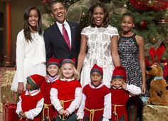 The Obamas with cheeky elves. Too cute!