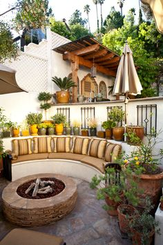 A nice outdoor seating area with a fire pit!