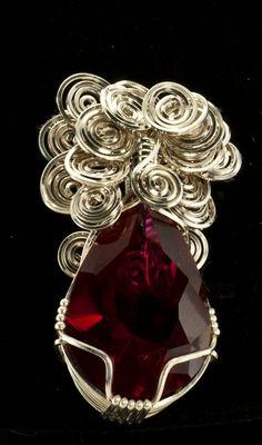 Ruby Pendant in Swirls of Silver