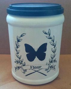 Recycled Plastic Coffee Containers with Krylon spray paint and slide-off decals. Plastic Coffee Cans, Plastic Coffee Containers, Plastic Container Crafts, Recycling Containers, Plastic Bottle Crafts, Recycle Plastic Bottles, Plastic Canisters, Recycling Ideas, Folgers Coffee Container