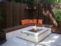 "Back corner idea - use wall benches to create additional ""area"" w/ firepit in middle"