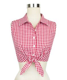 Inspired by the classic vintage styles of the South, Trashy Diva's Red Gingham Collection is here in new original designs and signature favorites. The new Dolly Tie Top in red gingham beams with country-chic charm just like her namesake. This design combines a few of our favorite retro elements to create a pretty sleeveless top. The button-down crop top details five buttons in the front meeting a knotted tie front for added vintage appeal. A pointed collar lends a timeless polish to this…