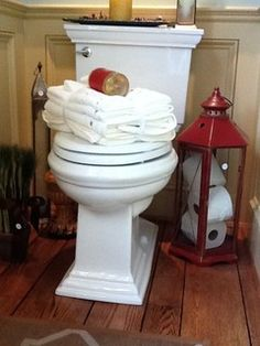 Houzz:  Use a tall lantern to hold spare toilet paper rolls