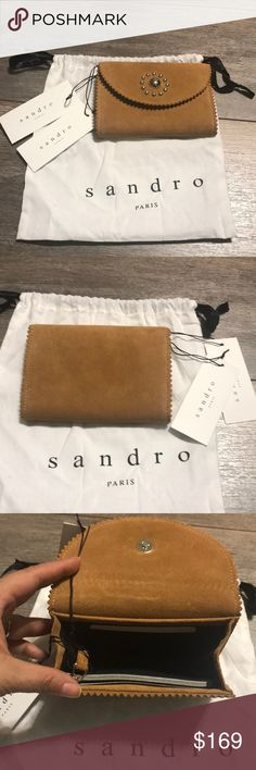 NWT Sandro tan suede wallet with dustbag. Sandra tan wallet in suede leather with silver bead hardware. 2 credit card slots, zipper pocket and spacious center compartment. New with tag and dust bag. Sandro Bags Wallets