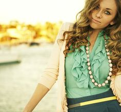 Love green on green and a ruffled blouse. Great outfit. Cool necklace by Thirty One Bits.