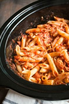 Slow Cooker Chicken Parmesan and Pasta     2 (24-oz.) jars Ragu Chunky Tomato, Garlic and Onion Sauce     1.5 lbs. boneless skinless chicken breasts     ¼ tsp. salt     ¼ tsp. pepper     ½ tsp. oregano     1 lb. penne pasta (cooked according to package directions)     3 cups shredded mozzarella cheese     ¼ cup Parmesan cheese