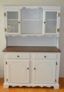 Solid oak hutch and buffet. Painted creamy white with a stained dark walnut buffet top. New makeover complete. Wish I had taken a before photo because it is an improvement!