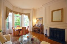 Enter the pristine, grand parlor-level living/dining room and notice the soaring 14 foot ceilings, original mouldings, ambient marble fireplace, radiant bay windows with original mahogany shutters and rich hardwood floors. #321Comm #sunnyside #BackBay #luxury #bostonhomes #bostondistinctiveproperties #RobbCohen