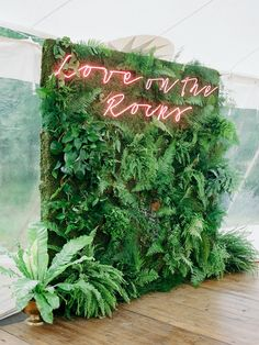tropical photo booth backdrop with neon signage
