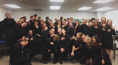Look at this loveable bunch! [photo of forty people all dressed in black making silly faces]