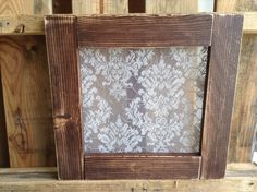 Wood frame pane-free window with vintage lace behind chicken wire, so you can hang pictures or memos, with a lovely lace background. Great for