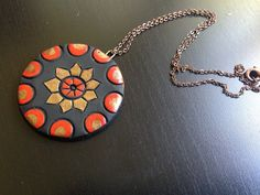 Red and antique gold terracotta earring and necklace by Mithicotta