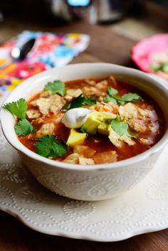 Slow Cooker Chicken Tortilla Soup This was a hit! The cilantro and lime are definitely a must as recipe suggests. Topped with avocado cheese and tortilla strips. Slow Cooker Tortilla Soup, Slow Cooker Recipes, Cooking Recipes, Sopa Tortilla, Mexican Tortilla Soup, Mexican Chili, Mexican Corn, Cooking Videos, Korma