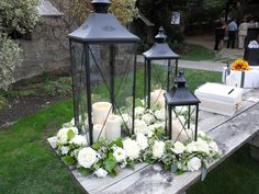 Lanterns with flowers for the gift or guest book table?
