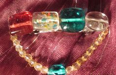 """medium silver colored hair clip with aqua,clear,red glass beads with loop dangle 2 1/2"""" by 1 1/2""""  product#H013 $5.00"""