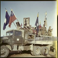 Anti-Communist, Chinese POWS are shown here on trucks with posters regarding Chiang Kai Shek.