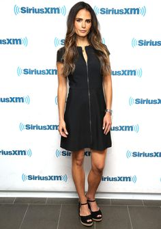 Jordana Brewster in a zip-up black dress