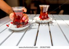 Turkish tea in traditional teacup and limpet on the white table