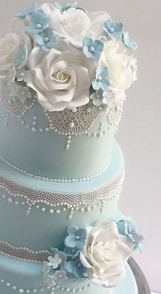This cake was for a beautiful wedding in a barn in Gloucester. I love the delicate feel that comes from the lace overlaying the pale blue sugarpaste. Extravagant Wedding Cakes, Pretty Wedding Cakes, Wedding Dress Cake, Wedding Cake Rustic, Elegant Wedding Cakes, Wedding Cakes With Flowers, Wedding Cake Designs, Pretty Cakes, Lace Wedding