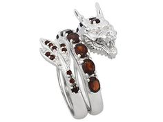 Garnet and white topaz, ss dragon ring.