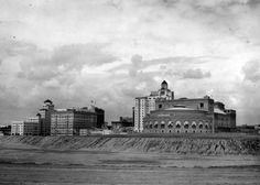 An unfilled Rainbow Lagoon surrounds the Long Beach Municipal Auditorium, circa 1931.By the 1960's wave action & tidal forces began to undermine the pier. Now home to the Convention Center and Aquarium of the Pacific.