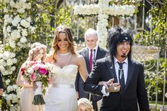 Mötley Crüe bassist Nikki Sixx and Courtney Bingham walked up the aisle arm in arm as husband and wife following the garden ceremony. #weddingceremony #decor Photography: Marc Royce Photography. Read More: http://www.insideweddings.com/weddings/courtney-bingham-and-nikki-sixx/573/