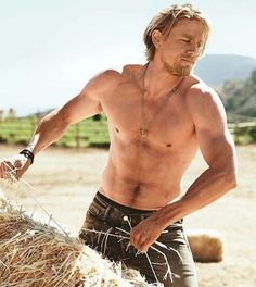 "Charlie Hunnam on the pressure to look good shirtless: ""F*cking Brad Pitt ruined it for everyone."""