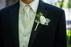 Give us a ranunculus boutonniere any day.