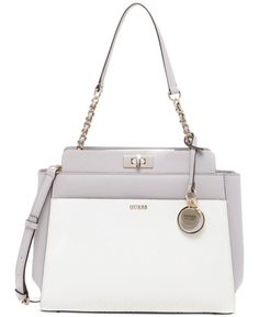 Keep your take-everywhere style chic. This shoulder bag from Guess has a triple-compartment design with a dedicated spot for all of your essentials, so it's simple to show off polished style while sta
