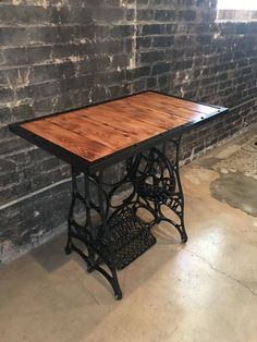 This item sold but can make another one upon Request. Custom table made from an old antique, New Home sewing machine.
