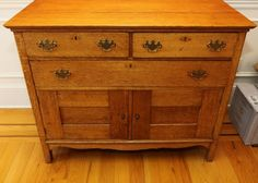 """Oak three drawer two door server having dovetailed construction with all matching metal batwing hardware 48"""" X 24"""" X 36.5""""T"""