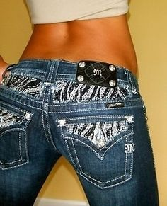 Miss me jeans zebra print on the waist with sparkles.