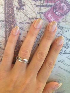 Nude oval nails with gold glitter