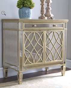 """Yes, I know!, """"impractical,"""" but I soooo want this on the wall between the foyer and living room. [[ Horchow mirrored chest ]]"""