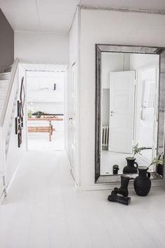 Bright, white spaces // #silvermirror #hallway   HarperandHarley