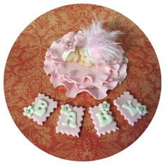 """Baby shower fondant cake topper 2 1/2"""" fondant baby in feather skirt on 4"""" fondant ruffle base. Baby cookie plaques 1"""" each FAQ Please read prior to purchase. Thanks! :~) ~PLEASE allow 5-10 business d"""