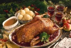 I grew up with roast goose or turkey in orange sauce for Christmas, with dumplings and red cabbage and a little bit of cranberry gelee on top