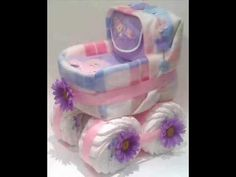 http://babyfavorsandgifts.com  How to make unique and creative Diaper Cake IDEAS The diaper cake, being a popular item for themed celebrations, is made from baby diapers arranged to look like an actual cake. It is a perfect gift for Arrival of Newborn, and Babys 1st Birthday, and can be given to new parents anytime after the baby is born. And ...