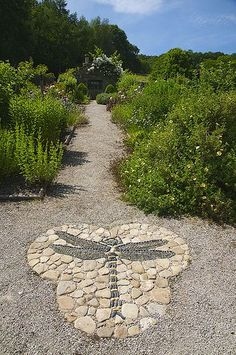 "Gresgarth Hall Brilliant pebble mosaic paving designed by Maggy Howarth adorns Arabella Lennox-Boyd's magical garden in Lancashire."", ""pinner"": {""username"": ""first_name"": ""Alison"", ""domain_url"": null, ""is_default_image"": true, ""image_medium_url"":. Garden Art, Patio Garden, Garden Projects, Garden, Garden Paths, Garden Crafts, Mosaic Garden, Outdoor Gardens, Rock Garden"