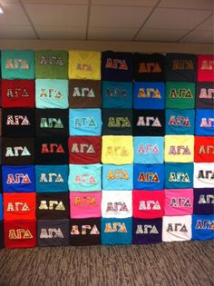 i've seen other sororities do walls of past shirts in their boring stairwells, cute idea if done right. we could put them in those cute pastel frames with the ornate woodwork