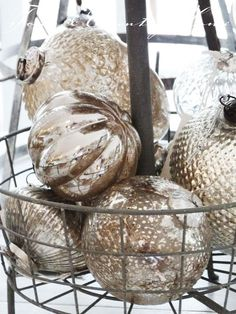 Would be cute centerpiece with mercury glass and metal basket