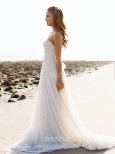 Beach chiffon empire a-line summer wedding dress. Ivory strapless bodice offers subtle sweetheart neckline with allover embellished detail, ethereal long chiffon skirt eases out from empire waist create elegant look, dainty tie accented on zip back.  #http://www.bridalfeel.com/strapless-floor-length-long-white-chiffon-summer-wedding-dress-493.html#  Coupon code: LoveFeel. 10% discount on any order. Expiry date: UNLIMITED