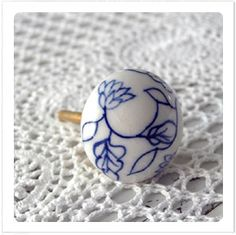 Ceramic knob with blue leaves