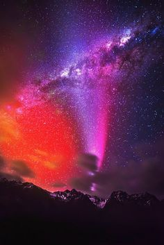 Colorful night light show above the mountains