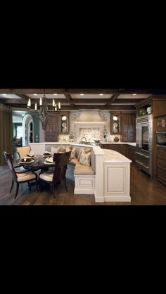 Kitchen idea..like the bench seating and the bar eat at counter on the other side...open to a family room area...
