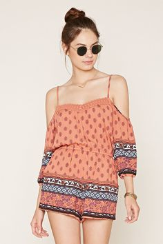 A woven romper featuring an allover floral print with adjustable cami straps, off-the-shoulder 3/4 sleeves, a crochet-trimmed V-neckline, elasticized cuffs, a V-cut back, an elasticized waist, and slanted front pockets.