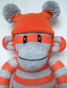 Orange and grey striped Sock Monkey with pom pom hat by Sunsetgirl