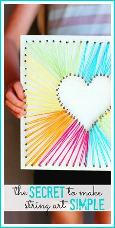 here's a simple way to do string art - - love this diy rainbow string art idea project using yarn! it'll make fun girls bedroom decor #michaelsmakers - - Sugar Bee Crafts #Crafts